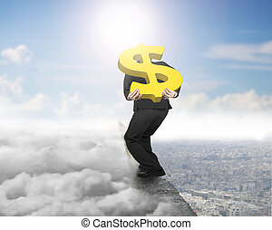 Businessman carrying gold dollar sign on ridge with cloudscape cityscape