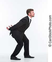 Businessman carrying heavy load on his back