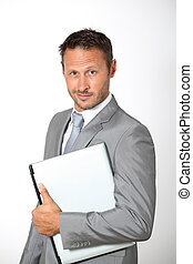 Businessman carrying laptop computer