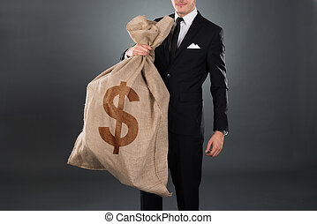 Businessman Carrying Sack With Dollar Sign