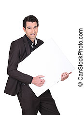 Businessman carrying white panel