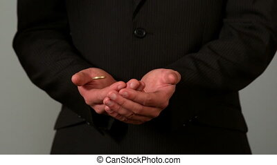 Businessman catching falling coins - Businessman catching...