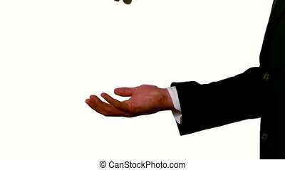 Businessman catching falling coins