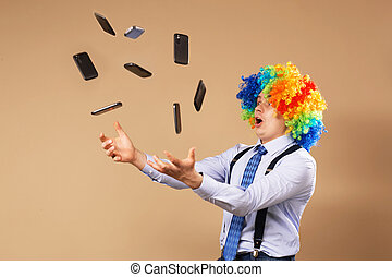Businessman catching mobile phones falling from above