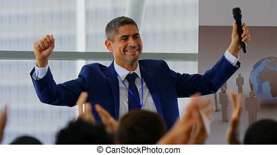 Businessman celebrating his success in the business seminar 4k