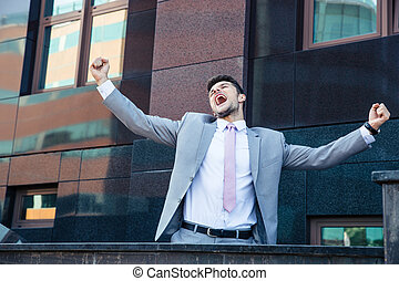Businessman celebrating his success outdoors