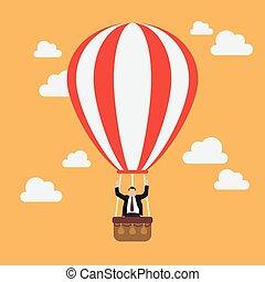 Businessman celebrating in hot air balloon