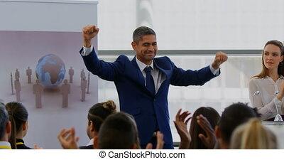 Businessman celebrating success in the business seminar 4k