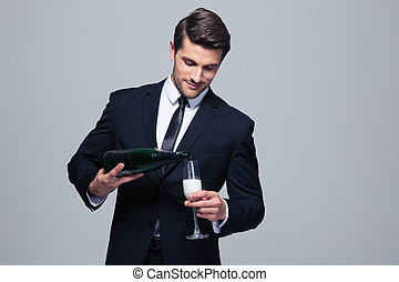Businessman celebrating success, pouring champagne