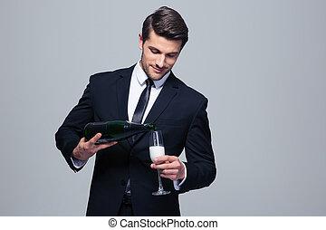 Businessman celebrating success, pouring champagne