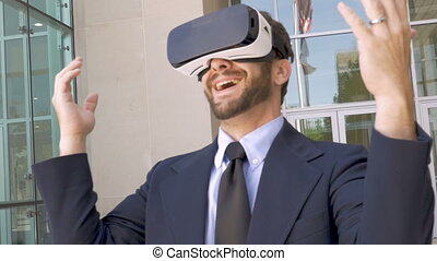 Businessman celebrating victory in a virtual reality experience with VR goggles