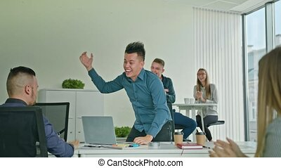 Businessman Celebrating Victory Looking at Laptop -...