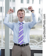 Businessman celebrating with his fists raised in the air