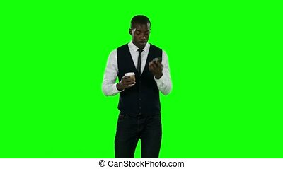 Businessman cell phone and drink coffee. Green screen