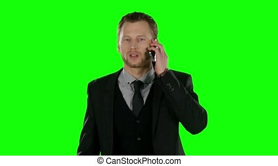 Businessman cell phone. Green screen