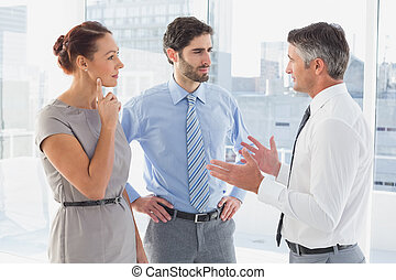 Businessman chatting with co-worker