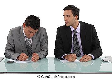 Businessman cheating in exam