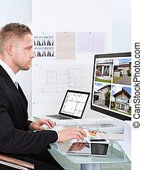 Businessman checking a property portfolio online