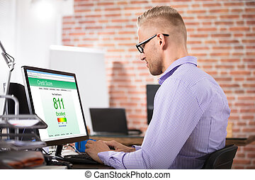 Businessman Checking Credit Score On Computer