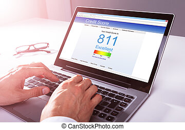 Businessman Checking Credit Score On Laptop