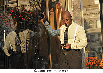 Businessman Checking Email on Mobile Phone