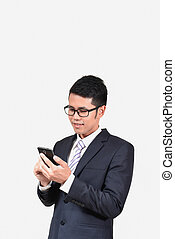 businessman checking emails on the phone