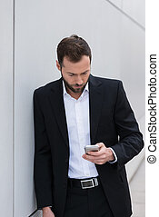 Businessman checking his mobile phone