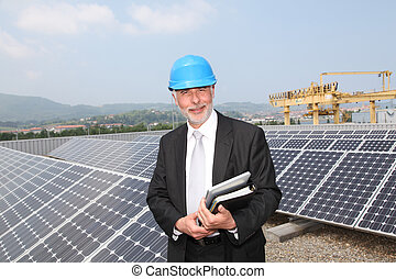 Businessman checking photovoltaic installation