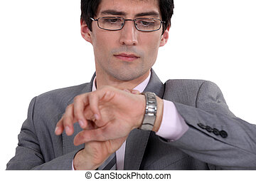 Businessman checking time on wrist watch
