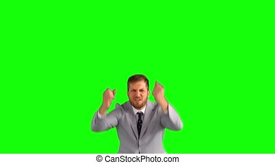 Businessman cheering and jumping on green screen in slow...