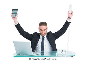 Businessman cheering holding calculator and telephone on...