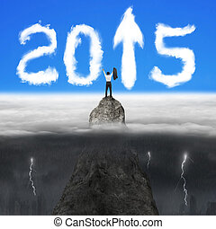 Businessman cheering on mountain peak for 2015 arrow sign clouds