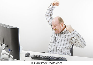 Businessman Cheering While Looking At Computer - Successful...