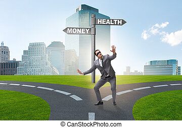 Businessman choosing between money and health