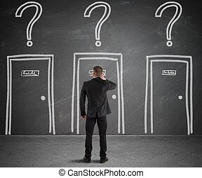 Businessman choosing the right door - Concept of a...