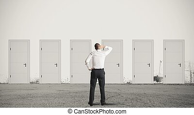 Businessman choosing the right door