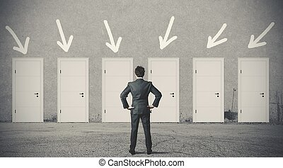 Businessman choosing the right door - Concept of businessman...