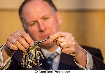 Businessman choosing the right key