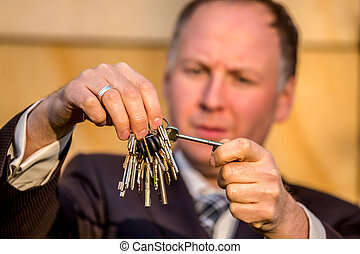 Businessman choosing the right key