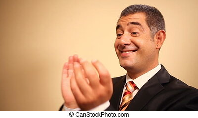 Businessman clapping hands - Cheerful businessman clapping...