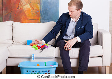 Businessman cleaning child's toys - Horizontal view of ...