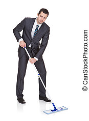 Businessman cleaning floor. Isolated on white background