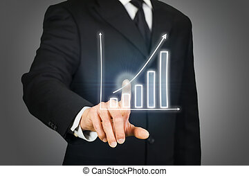 Businessman clicking on a rising chart on a virtual...