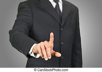 Businessman clicking on touch screen