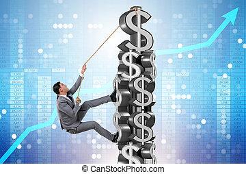 Businessman climbing dollar challenge tower