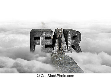 Businessman climbing ladder conquering fear word on ridge...