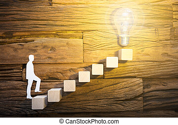 Businessman Climbing Ladder Leading Towards Lightbulb