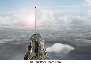 businessman climbing on peak with blank flag and sunlight clouds
