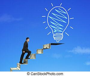 Businessman climbing the money stairs toward light bulb