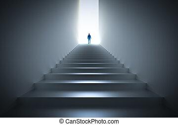 Businessman climbing the stairs towards light.